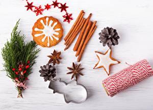 Обои Корица Выпечка Печенье Праздники Новый год Бадьян звезда аниса Шишки Еда фото