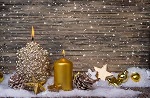 Фотографии Свечи Праздники Рождество Шишки Шарики Снежинки