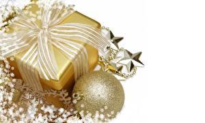 Фотографии Праздники Рождество Шарики Подарки Бантик Золотой