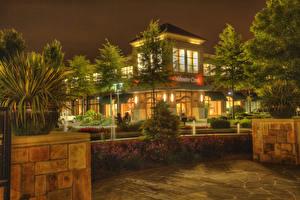 Фотографии США Парки Диснейленд Дома Калифорния Анахайм Деревья Кусты Ночь Уличные фонари Города