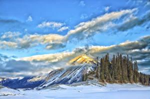 Фото Озеро Горы Зима Пейзаж Облачно Природа
