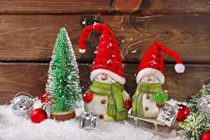 Фото Праздники Рождество Снеговики Шапки Шарики