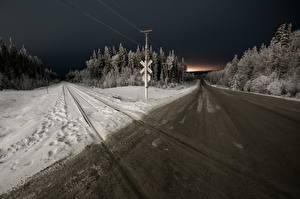 Фото Дороги Зимние Леса Железные дороги Ночные Снег Природа