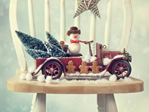 Обои Выпечка Печенье Игрушки Праздники Новый год Снеговики Стулья фото