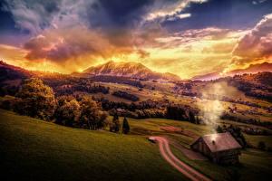 Обои для рабочего стола Швейцария Пейзаж Рассветы и закаты Гора Луга Здания Небо Облако Amden Природа