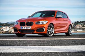 Картинки BMW Оранжевый 2015 M135i 3-door F21 Автомобили