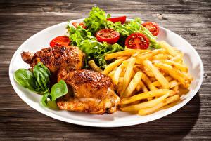 Обои Вторые блюда Курица запеченная Картофель фри Овощи Тарелка Еда фото