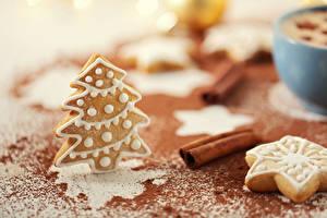 Фотографии Печенье Рождество Корица Выпечка Ель Продукты питания