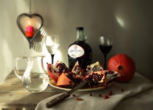 Фотографии Вино Гранат Свечи Ножик Бутылки Бокал Кувшины Сердце Зерно Пища