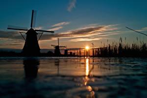 Фото Вечер Рассветы и закаты Небо Мельницы Силуэт Природа