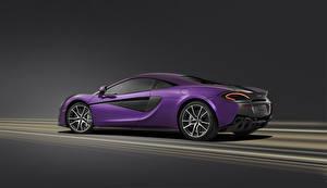 Обои McLaren Фиолетовый Сбоку Автомобили фото