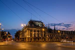 Фото Польша Дома Небо Улица Ночь Уличные фонари Lodz Города