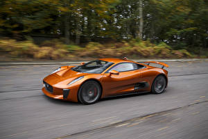 Картинки Jaguar Оранжевый Металлик Дорогие Движение 2015 C-X75 Spectre concept Автомобили