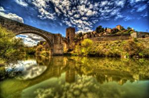 Фотографии Испания Дома Реки Мосты Толедо HDR Облака
