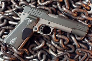 Фотография Пистолеты Крупным планом Цепь Taurus Армия