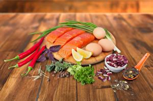 Фотографии Морепродукты Рыба Лимоны Перец Яйца