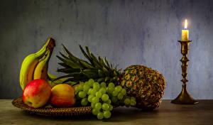 Обои Фрукты Свечи Ананасы Бананы Яблоки Виноград Еда фото