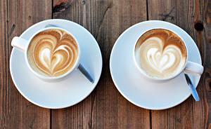 Фотография Напиток Кофе Капучино Чашке Вдвоем Блюдца Пища