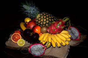 Фотография Фрукты Ананасы Бананы Гранат Киви Драконий фрукт Еда