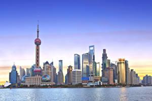 Фотографии Китай Шанхай Дома Небоскребы Вечер Города