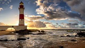 Картинка Пейзаж Бразилия Маяки Небо Океан Облака Salvador Bahia Природа