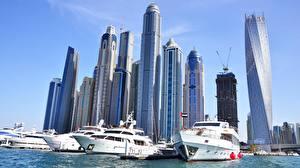 Картинка Небоскребы Дубай Яхта Объединённые Арабские Эмираты Здания Города