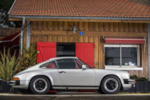 Фото Porsche Винтаж Серебристый Сбоку 1976-77 911 Carrera 3.0 Coupe Автомобили
