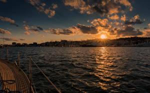 Картинки Испания Рассвет и закат Море Небо Мальорка Майорка Облачно Солнца Palma Habour Природа