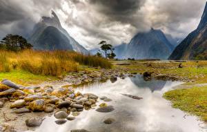 Картинки Горы Пейзаж Камни Новая Зеландия Лужа