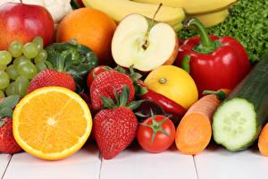 Картинка Фрукты Овощи Клубника Апельсин Яблоки Помидоры Морковь Перец Продукты питания