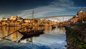 Обои Португалия Дома Речка Мосты Лодки Небо Порту
