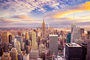 Фотография США Небоскребы Небо Нью-Йорк Мегаполис Облака Города