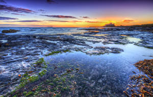 Фотографии Англия Побережье Рассветы и закаты Небо Bamburgh Beach Природа