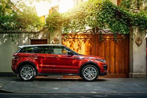 Фото Land Rover Красный Металлик Сбоку 2016 Range Rover Evoque HSE Dynamic Автомобили
