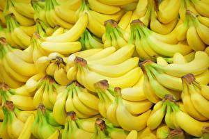 Обои для рабочего стола Фрукты Бананы Много Текстура Еда