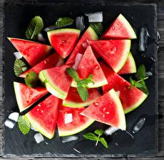 Картинка Арбузы Лед Листва Кусок Продукты питания