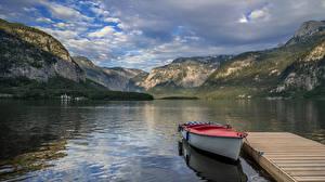 Фотографии Австрия Гора Озеро Пристань Лодки Пейзаж Халльштатт Облако Природа