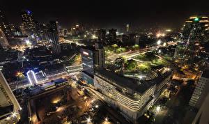 Фото Индонезия Дома Дороги Ночь Уличные фонари Сверху Jakarta Города