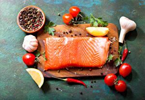 Фотографии Морепродукты Рыба Помидоры Чеснок Лимоны Специи Пища