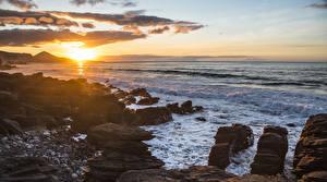 Обои Испания Море Рассветы и закаты Побережье Солнце Скала Norte de Gran Canaria Природа фото