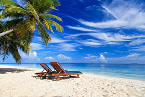 Картинка Небо Лето Море Тропики Пляж Лежаки Природа