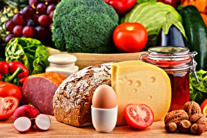 Картинки Натюрморт Овощи Томаты Капуста Хлеб Сыры Орехи Ветчина Яйца Банка Пища