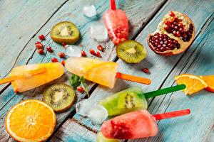 Фотография Сладости Мороженое Фрукты Гранат Киви Апельсин Лед