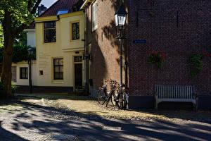Картинка Голландия Здания Скамья Велосипед Naarden Города