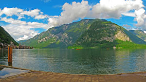 Картинка Австрия Озеро Горы Небо Халльштатт Облака Природа