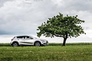 Фото Infiniti Серебристый Сбоку Трава Деревья 2016 QX30 2.2d AWD Машины Природа