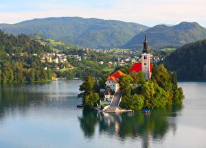 Картинки Словения Здания Остров Горы Озеро Храмы Bled Города
