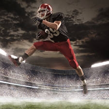 Фотографии Мужчины Американский футбол Униформа Шлем Ног Прыгает спортивные