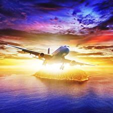Фотографии Самолеты Небо Вода Пассажирские Самолеты Облака
