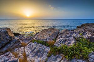 Обои Греция Пейзаж Рассветы и закаты Камни Море Солнце Crete Природа фото